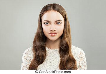 Beautiful young woman portrait. Pretty girl smiling