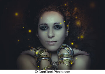 beautiful young woman portrait with long, mysterious lights floating around her