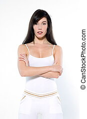 beautiful young woman portraits in workout sportswear on studio white isolated background standing
