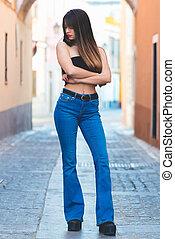Beautiful young woman posing in the street