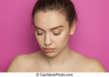 young woman posing on pink background
