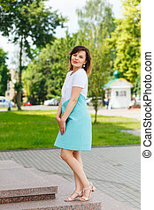 Beautiful young woman posing on the street