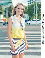 Beautiful young woman posing on the street.