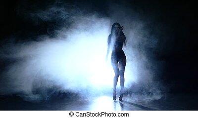 beautiful young woman posing. Slow motion, smoke