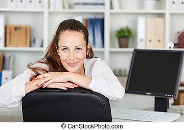 Beautiful young woman posing while working