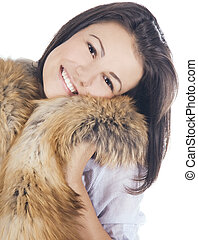 beautiful young woman posing with a fur