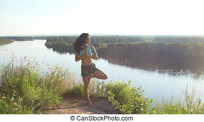 Beautiful young woman practices yoga.
