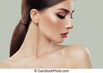 Beautiful Young Woman Profile. Healthy Skin and Hair