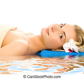 Beautiful young woman ready for spa threatment near the water