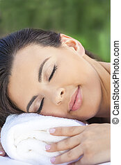 Beautiful Young Woman Relaxing At Health Spa