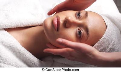 Beautiful Young Woman Relaxing Female Receiving Facial Body Massage Beauty Spa.