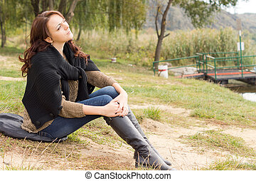 Beautiful young woman relaxing in nature