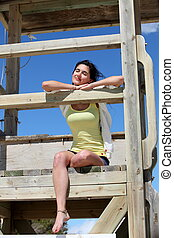 Beautiful young woman relaxing on a deck