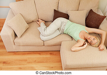 Beautiful young woman relaxing on a sofa