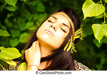 Beautiful young woman resting outdoors