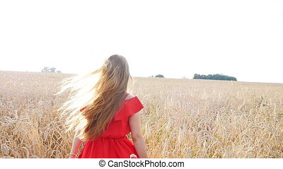 beautiful young woman run away in yellow wheat field