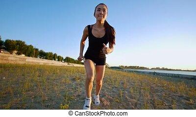 Beautiful Young Woman Runs Up