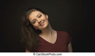 Beautiful young woman shaking hair
