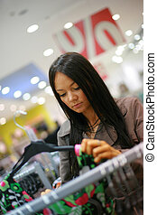 Beautiful young woman shopping in a store
