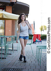 beautiful young woman shopping outdoor in summer