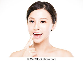 beautiful young woman showing her teeth