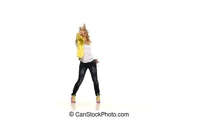 Beautiful, young woman shows dancing sexy-jazz moves on white background, slow motion