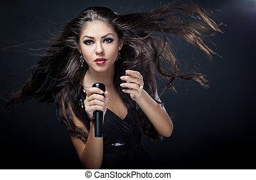 beautiful young woman singer
