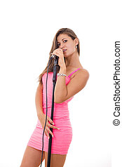 beautiful young woman singing on microphone