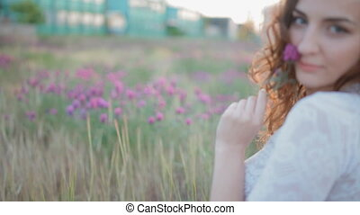 Beautiful young woman sit in the field