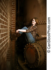 Beautiful Young Woman Sitting by Boiler