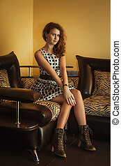 Beautiful young woman sitting in a shoes
