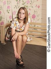 Beautiful young woman sitting