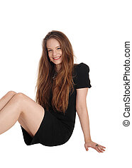 Beautiful young woman sitting on floor