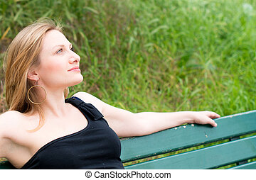 woman sitting on the bench