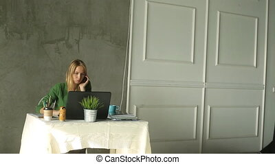 Beautiful young woman sitting with laptop