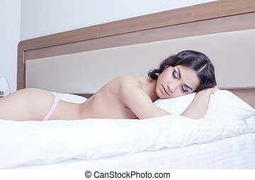 Beautiful young woman sleep on morning bedrom