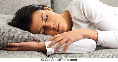 Beautiful Young Woman Sleeping On Sofa