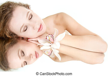 beautiful young woman sleeping over white