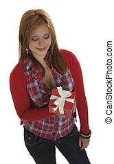 Beautiful young woman smiling at a present view from above