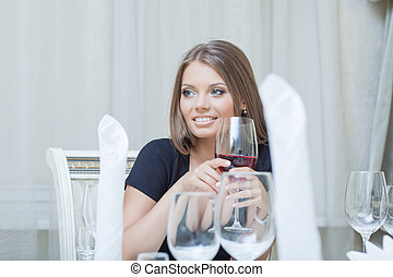 Beautiful young woman smiling in restaurant