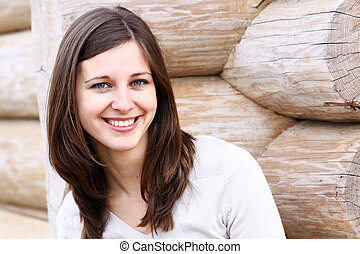Beautiful young woman smiling. Outdoor portrait