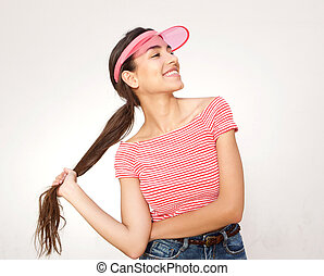 Beautiful young woman smiling with hand in long hair