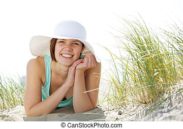 Beautiful young woman smiling with hat