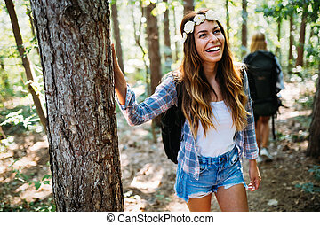 Beautiful young woman spending time in nature