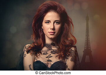 beautiful young woman standing in front of wonderful eiffel tower background