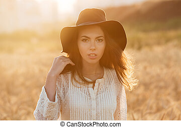 Beautiful young woman standing in the field