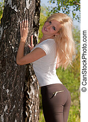woman standing near a tree
