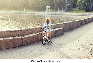 woman standing next to her bike
