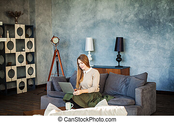Beautiful Young Woman Student Working on Laptop at Home