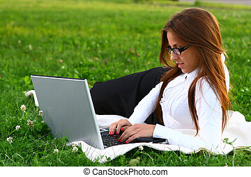 beautiful young woman studing in park